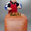 Kid learning to play chess — Stock Photo #47901589