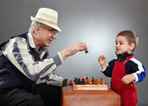 Grandfather and grandson playing chess — Stock Photo