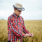 Teenage boy in a wheat field — Stock Photo #48409439