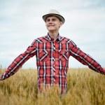 Teenage boy in a wheat field — Stock Photo #48409451