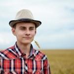 Teenage boy in a wheat field — Stock Photo #48409461