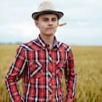 Teenage boy in a wheat field — Stock Photo #48409463