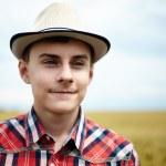Teenage boy in a wheat field — Stock Photo #48409517