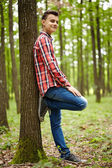 Trendy teenager in the forest — Stock Photo