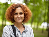 Redhead lady in the park, closeup — Stock Photo