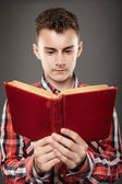Teenager reading an old book — Stock Photo