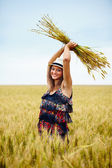 Happy young woman in wheat field — Stock Photo