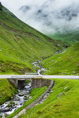 Winding road in mountains — Stock Photo