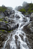 Waterfall on mountain — Stock Photo