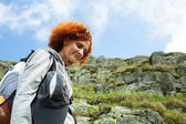 Hiker lady in mountains — Stock Photo