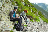 Mother and son hiking in the mountains — Stock Photo