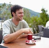 Man having coffee outdoor — Stock Photo