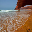 Arch rock formation on the beach. Morocco. — Stock Photo #31650049