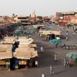 Market in the famous public square, in Marrakech, Morocco on Dec. 24, 2012. — Stock Photo #31765629