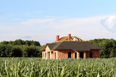 Construction site of a new house at corn field — Stock Photo