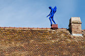 Blue statue on the roof — Stock Photo
