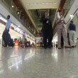People with bags walking in the airport — Stock Video