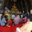People praying in a temple — Stock Photo