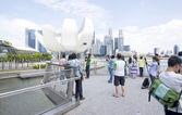 People walking on Helix Bridge — Stock Photo
