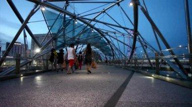 People on the Helix Bridge — Stock Video