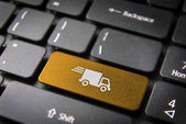 Yellow delivery keyboard key cargo business background — Stok fotoğraf