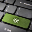 Go green keyboard key with earth, ecology background — Stock Photo