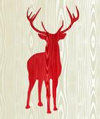 Silueta de madera reno de navidad — Vector de stock