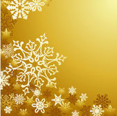 Golden Christmas snowflakes background — Stock Vector