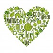 Green heart with environmental icons — Stock Vector