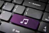 Purple Music note keyboard key, Entertainment background — Stock Photo