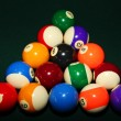 Billiard balls on a green pool table — Stock Photo