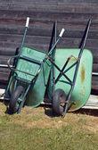Green wheelbarrows — Stock Photo