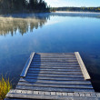 Wooden dock on lake — Stock Photo