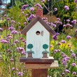Little white birdhouse - Stock Photo