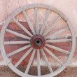 Old wooden wagon wheel — Stock Photo