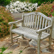 Garden bench on patio — Stock Photo