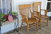 Wooden chairs on porch — Stock Photo