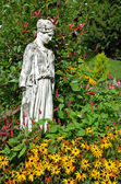 Goddess statue in garden — Stock Photo