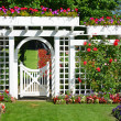 Stock Photo: White garden gate with flowers