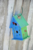 Little blue and green birdhouse — Stock Photo