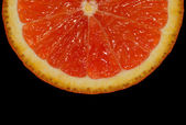 Orange slice on black — Stock Photo