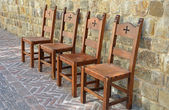 Medieval chairs on brick patio — Stock Photo