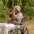 Stock Photo: Disabled bird watcher