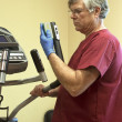 Cleaning excercise equipment — Stock Photo