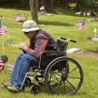Disabled man at the cemetery — Stock Photo