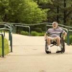 Using a concrete wheelchair access ramp — Stock Photo #47759611