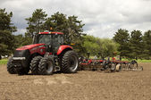 Tractor and disk harrow — Stock Photo