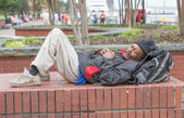 African american homeless man sleeping — Stock Photo