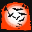 Halloween background - flying bats in full moon — Image vectorielle