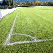 Soccer football field stadium grass, white line, light shadow on — Stock Photo